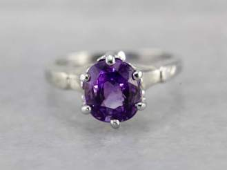 13. Purple Sapphire Solitaire Engagement Ring